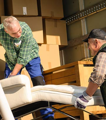 Massachusetts professional movers moving furniture in the TLC truck